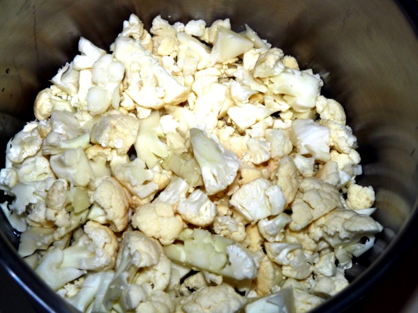 Cut cauliflower into florets and steam in a covered saucepan with an inch of water for about 7-8 minutes