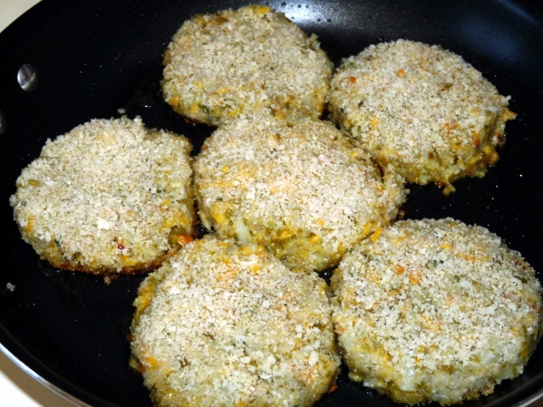 Baste burgers with egg white and dip in remaining panko crumbs before adding to heated skillet