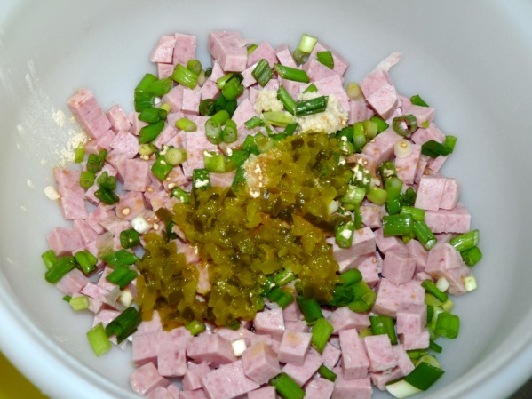 Add finely diced Spam, green onions and pickle relish to bowl