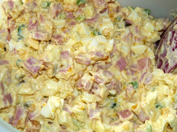 Peel and dice eggs; stir into salad