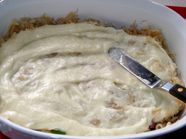Spread 1/3 of the cheese sauce with a knife or offset spatula