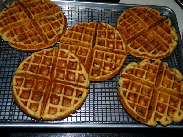 Keep waffles warm and crisp on a rack in the oven