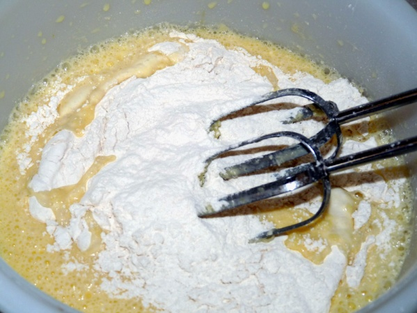 Whisk dry ingredients in a separate bowl and add slowly to dry ingredients