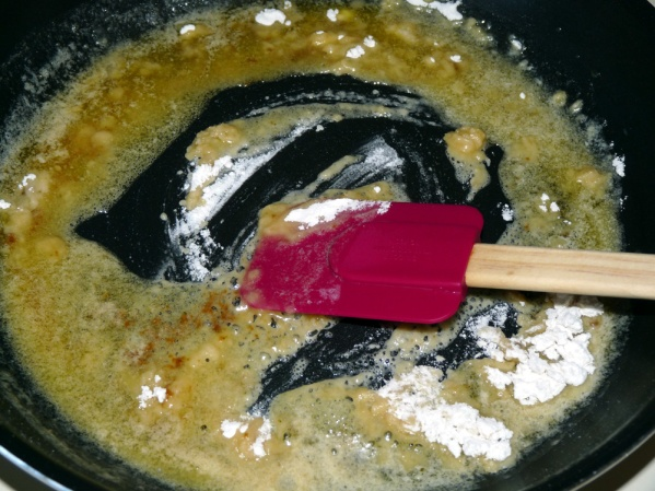 Melt butter and stir in flour, cooking several minutes to cook out the raw flour flavor.  Basically we're making a roux