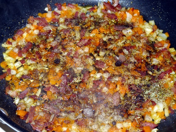 Saute bacon until almost browned; add peppers and onion and continue sauteeing until the onions are translucent