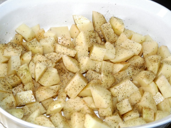 """Peel and dice potatoes into 1"""" pieces.  Layer in sprayed baking dish and sprinkle with salt and pepper"""