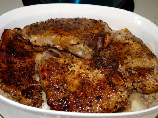 Layer the chops over the potatoes