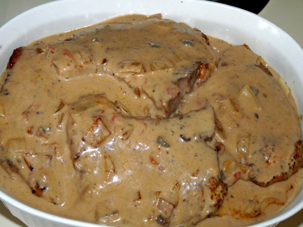 Spoon the rest of the mushroom gravy over the pork chops and place in oven