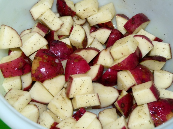 Scrub potatoes and cut into chunks.  In a bowl toss with oil, salt and pepper.  Lay out on baking sheet and roast until fork tender.
