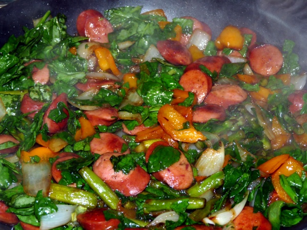 Stir in chopped spinach a sauté until it is wilted