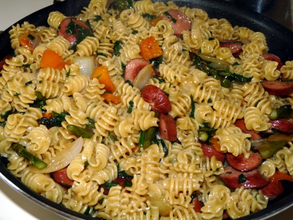 Add pasta and oil to skillet and toss to mix