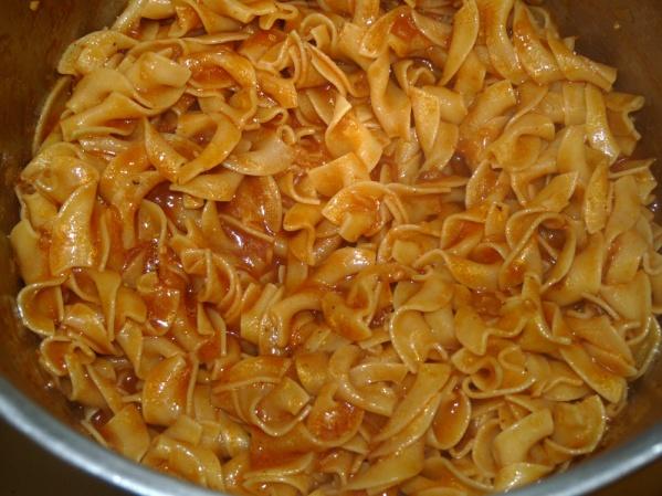 Stir al dente egg noodles into sauce and let them soak up the liquid for a few minutes, stirring often