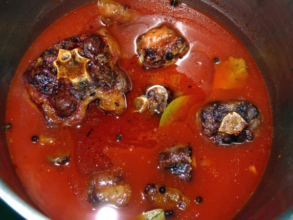 Add oxtails to pot, bring to a bubble then reduce heat to medium low and cover