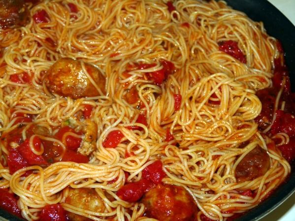 Toss pasta with the meatballs and sauce, allowing it to cook a few minutes to absorb the sauce. Add pasta water if it becomes too dry