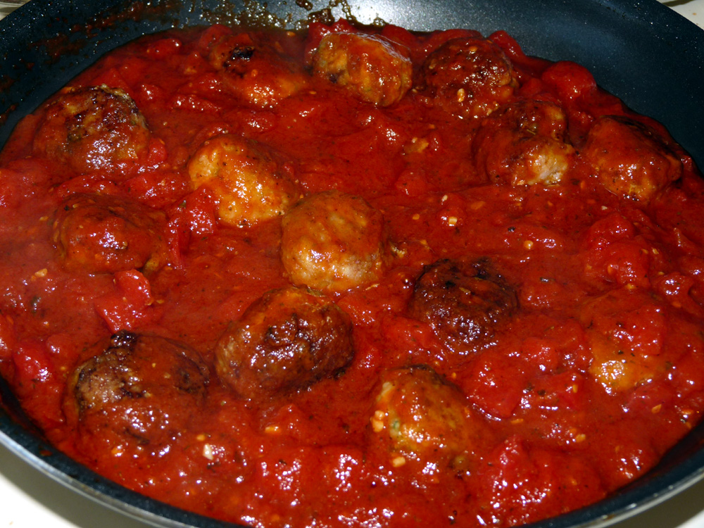 Add half of the meatballs to the marinara and cook for several minutes to marry the flavors