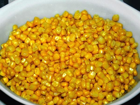 Put corn into a baking dish or a sprayed crockpot