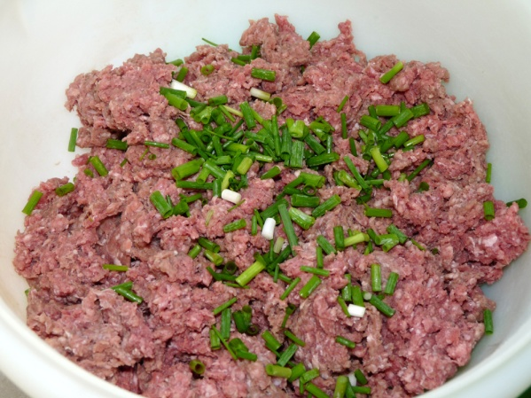 Measure meatloaf ingredients into a large bowl