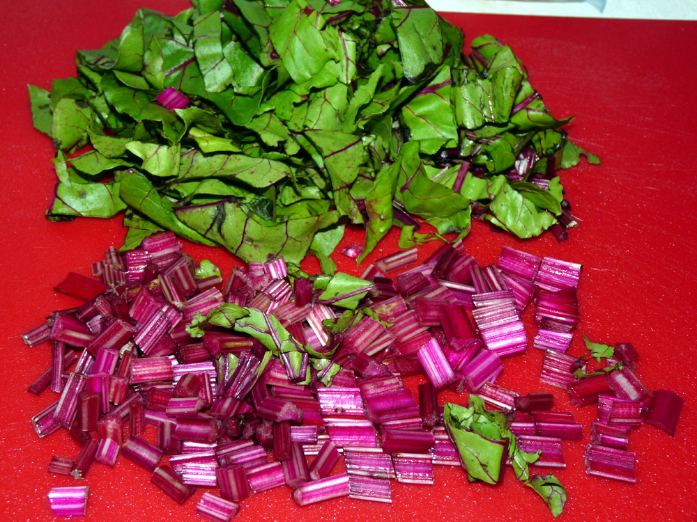 Chop beet greens and stems, keeping them separate
