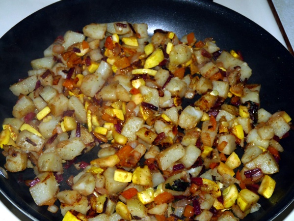 Stir potatoes and summer squash into the skillet