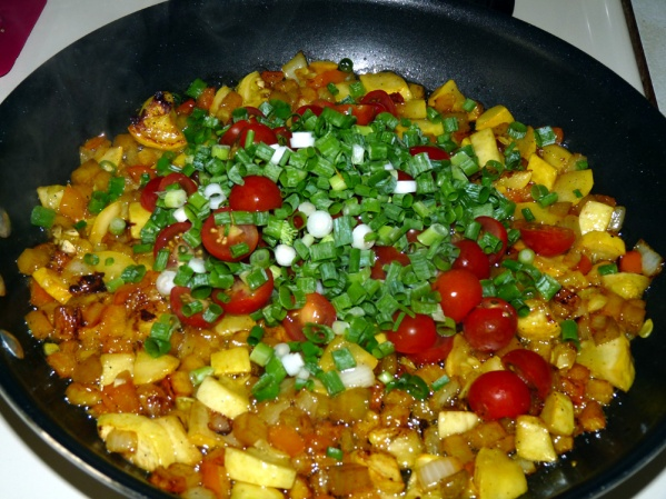 Stir in cherry tomatoes and green onions and let tomatoes heat through