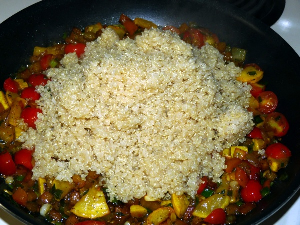 Add cooked quinoa and stir well. Let it cook a few minutes to combine the flavors