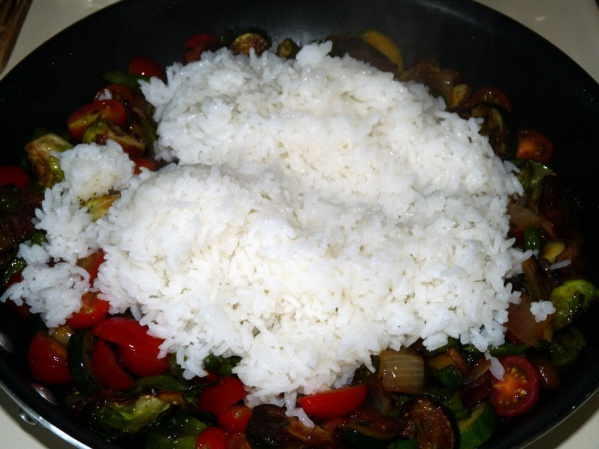 Cook rice, fluff, add to skillet