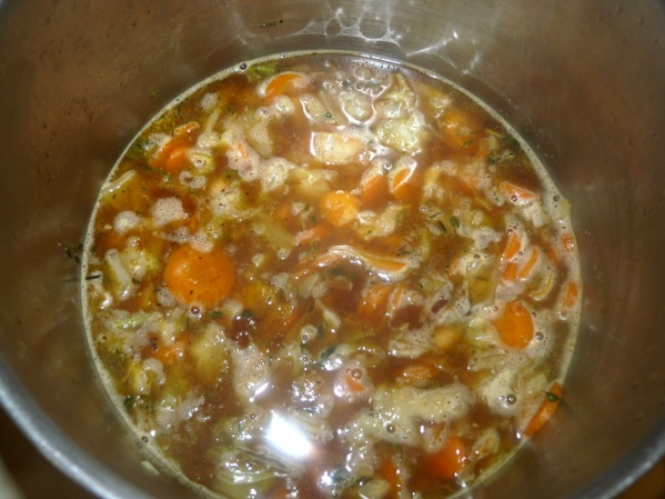 Add broth and white beans. Let it come to a boil, then reduce to medium low and simmer for 20 minutes