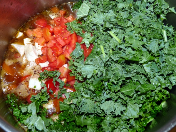 Add kale and cherry tomatoes and simmer until the kale is tender and the tomatoes are heated through