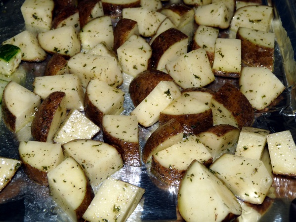 Wash and dice potatoes; toss them with oil, salt and pepper