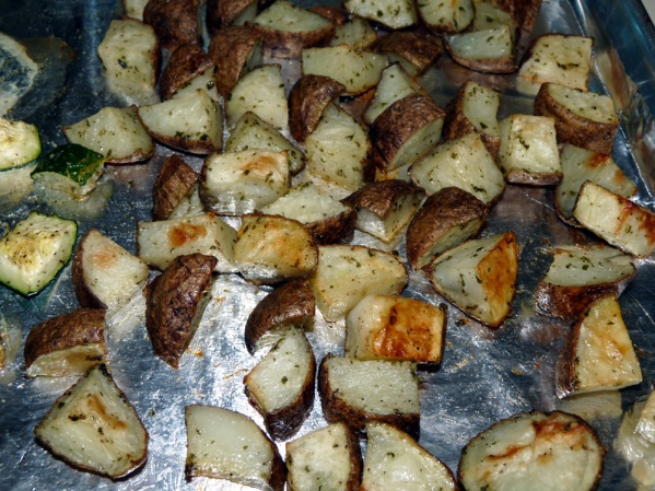Bake until chicken is done and potatoes and zucchini are browned, about 40 minutes