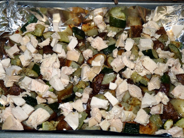 Place roasted potatoes and zucchini in a foil lined 9x13-in pan. Add diced chicken