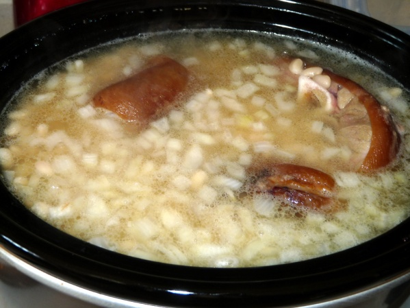 Place beans, ham hocks and onions in crockpot then fill with fresh water. Cook on high 3-4 hours until beans are softened