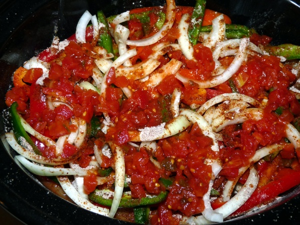 Layer remaining peppers, onions, diced tomatoes and fajita seasoning