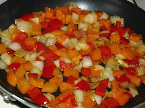 Saute onion and pepper until onion begins to turn translucent