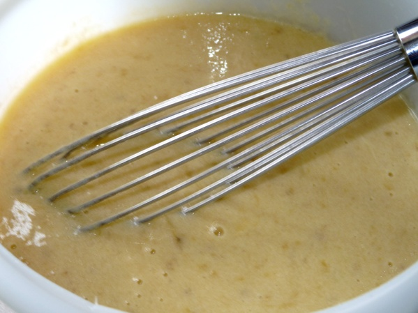 Mash bananas until mostly smooth and mix with eggs, buttermilk, vanilla and oil