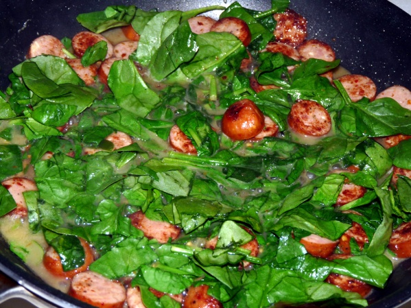 Add chicken broth, wine, lemon juice and bring to a bubbling boil. Add spinach and stir until wilted