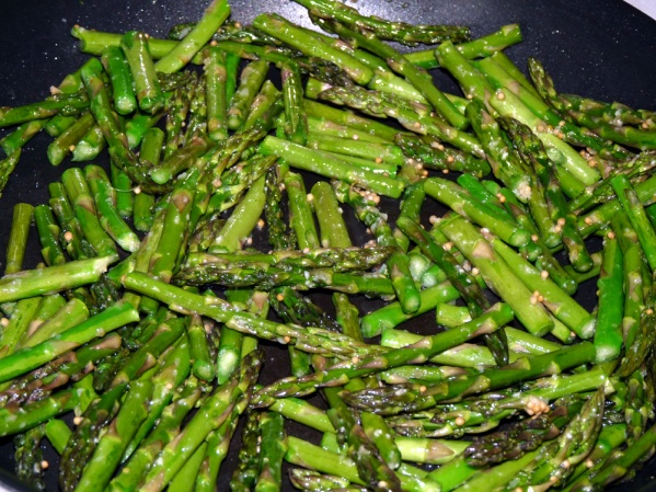 Saute asparagus in bacon drippings just until it begins to soften. Stir in mustard seeds