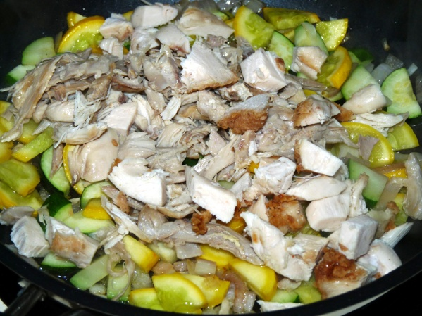 Sauté squash for several minutes then add chicken and cook several more minutes until heated through