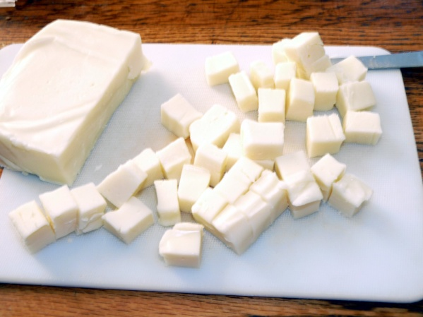 "Cut fresh mozzarella into 1/2"" cubes"