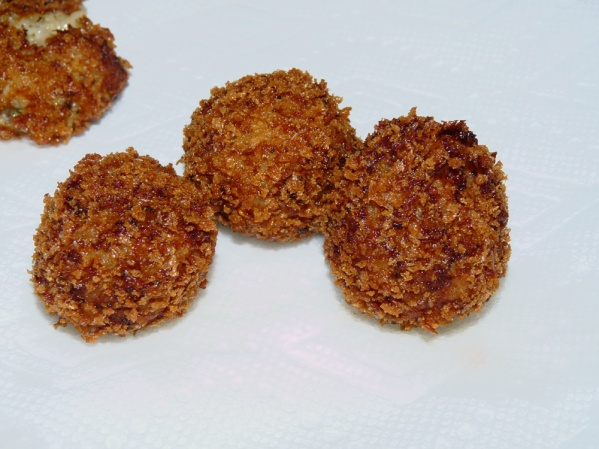 Remove arancini from oil with a slotted spoon and place on paper toweling
