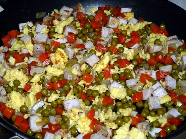 Scramble eggs and mix with carrots, peas, onions and pork
