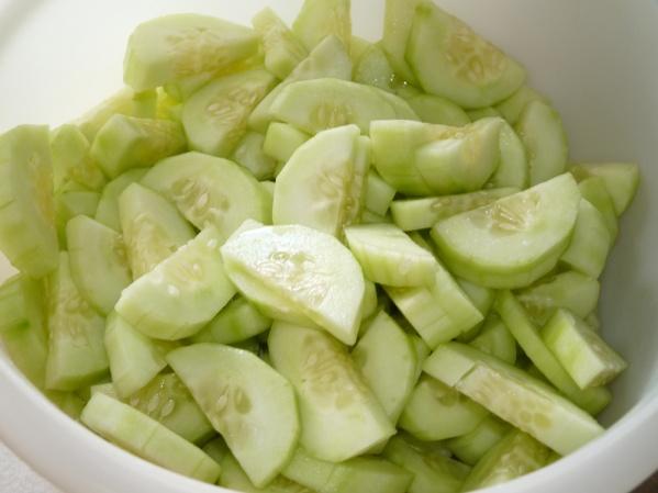 Peel, halve and slice cucumbers