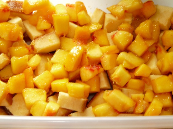 After the sherry is sprinkled over half of the pound cake cubes and a layer of half of the diced peaches