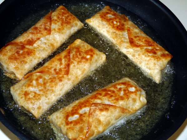 Having your heat low enough so that the egg rolls aren't instantly browned will help the filling heat and the cheese melt as they cook longer