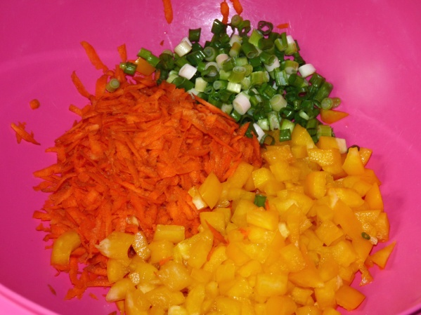 Shred carrots, dice pepper and green onions