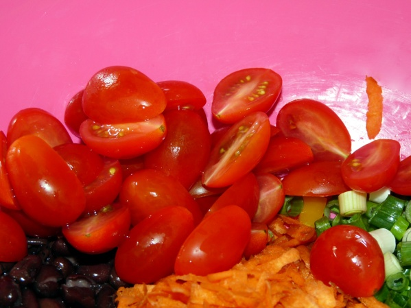 Rinse beans, halve cherry tomatoes