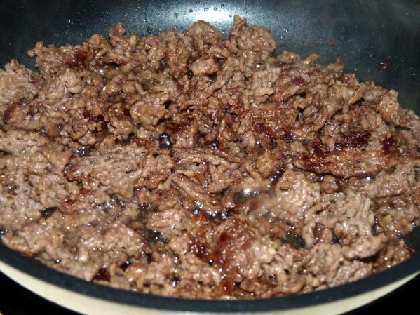 Fry ground beef until browned. Drain