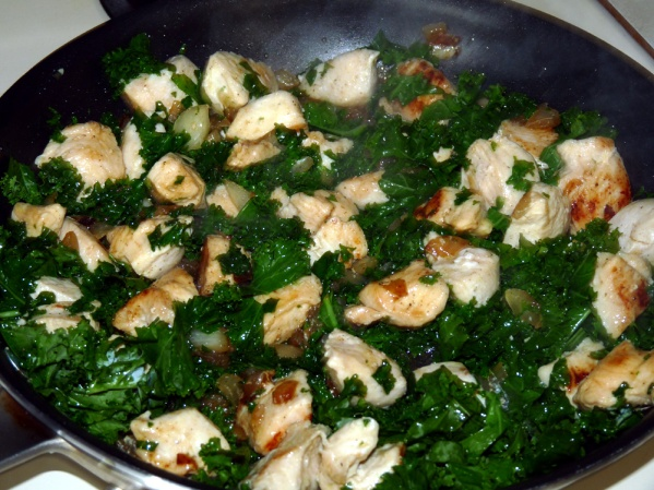 Add kale and another drizzle of olive oil. Cook until kale is wilted. Add minced garlic and sauté a few more minutes
