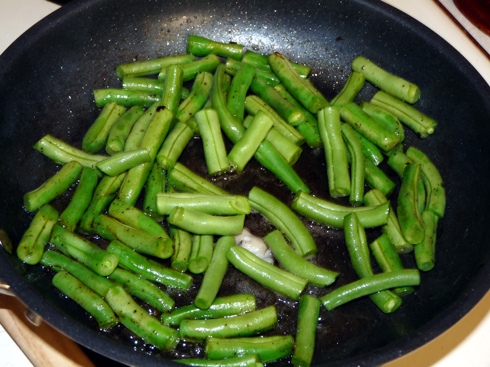 Fry green beans in a tablespoon of bacon grease for 6-7 minutes or they begin to soften