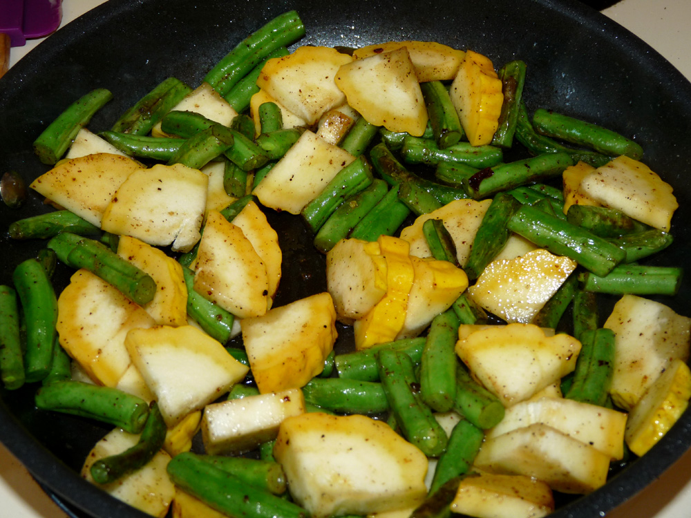 Add squash to green beans and fry for 5 minutes, stirring occasionally until squash begins to brown around the edges